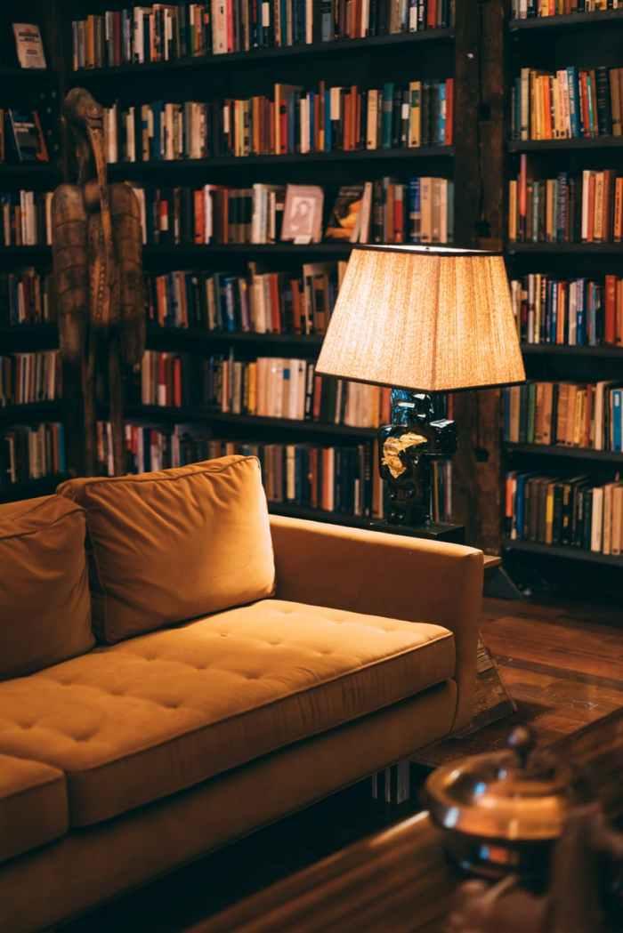 turned on floor lamp near sofa